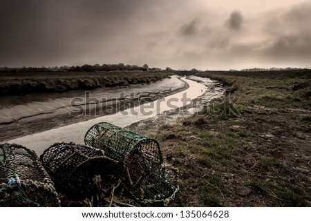 Marshes & crab pots on the river on the east coast in Lincolnshire, England.