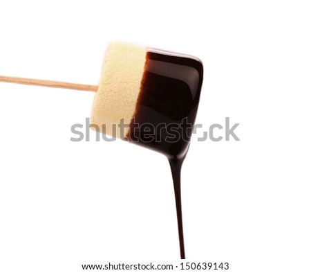 Marshmallow in chocolate syrop. Isolated. White background.