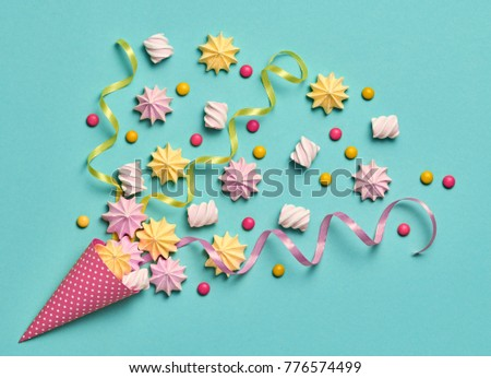 Marshmallow, Meringue background. Ice Cream Cone with Candies Sweets. Flat lay. Summer Party, Birthday Firework. Vanilla Pastel Color. Trendy fashion Style. Minimal. Art
