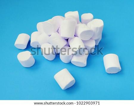Marshmallow pile set. Top air view. Minimal flat lay design. Marshmallows. Sweet food. Blue pastel bright background.