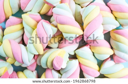 Marshmallows. Chewy candy close-up on a turquoise background. The dessert of sweet food. Pastel colors. Copy of the text space. Stock photo ©