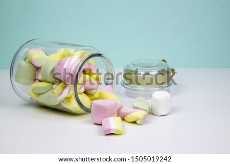 Marshmallows in an upturned glass vase