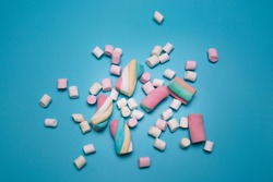 Marshmallows on the blue background, flat lay.