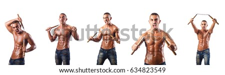 Martial arts warrior with nunchucks on white #634823549