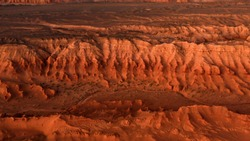 Martian landscape, Flaming Cliffs aerial view in the Gobi Desert. Scorched earth where the remains of dinosaurs rest, and the layings of their eggs. Mongolia. Canyon Herman-Tsav.