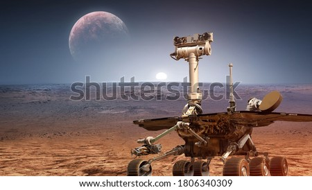 Martian rover Curiosity on surface of red planet Mars. Research of red planet. Perseverance 2020 rover. Elements of this image furnished by NASA Foto d'archivio ©