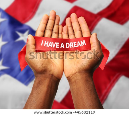 Martin Luther King Day. Male hands on Flag of United States of America background