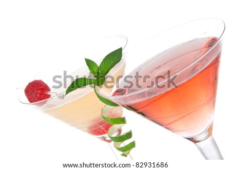 Martini alcohol cocktails in row  tequila sunrise, garnished with raspberry, lime, mint in martinis cocktail glasses on a white background