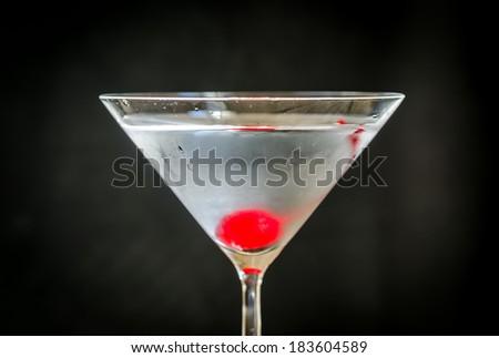 Martini cocktail with maraschino cherry