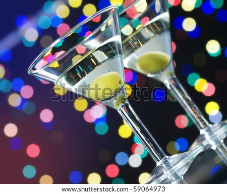 Martini cocktail with olive - stock photo