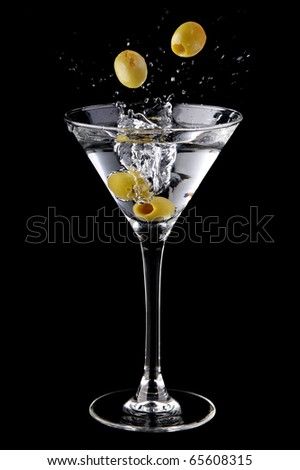 Martini cocktail with olives and splash