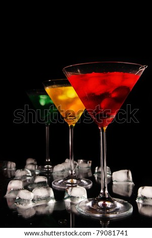 Martini drinks on black background