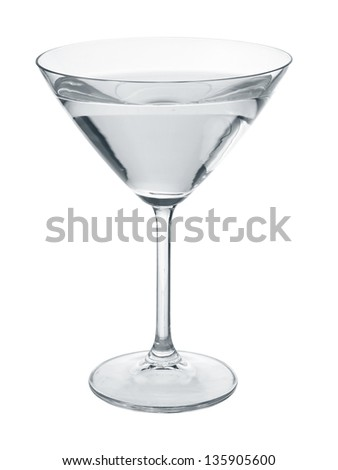Martini glass filled with transparent colorless liquid isolated on white..