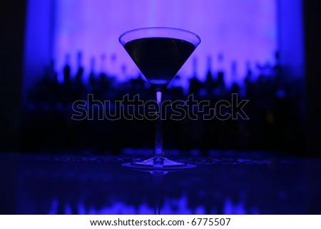 martini glass on blue background