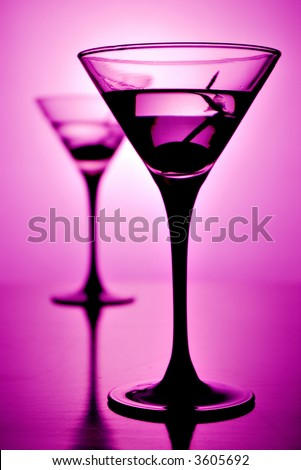 Martini glass on purple background (shallow depth of field)