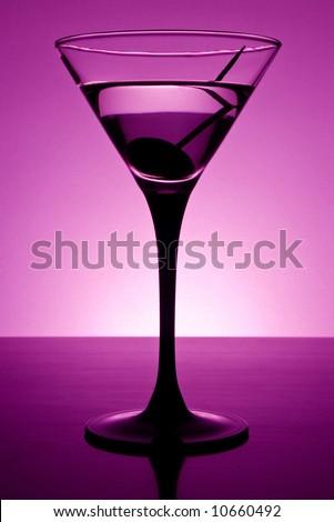 Martini glass on table in purple light