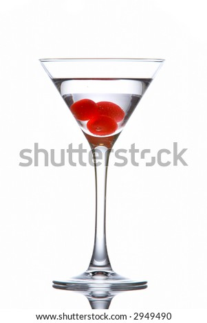 Martini glass with cherries reflected on white background