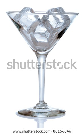 Martini glass with ice cubes blue color - stock photo