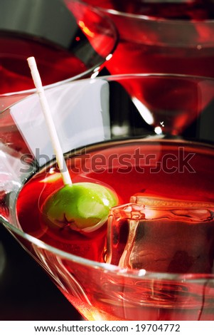 Martini glasse with olive and ice