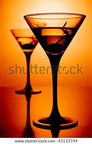 martini glasses on hot background