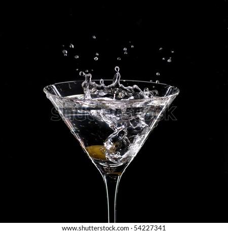 Martini splash on black background - stock photo