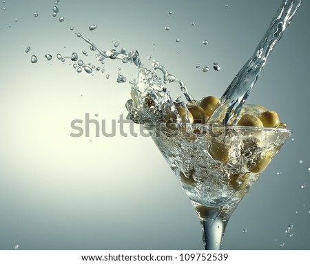 Martini with olives on gradient background