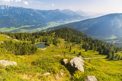 Marvelous landscape of Schladming Dachstein region with high mountains as seen from Planai, Stoderzinken, Kammspitze and Grimming in the background, Austria