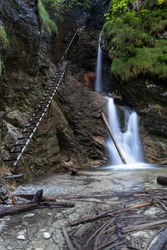 Marvelous long exposure view to the Misovy vodopad (waterfall) ladders along, on Sucha Bela, most popular and one of the most attractive trails in Slovensky raj National Park in a autumn day, Slovakia