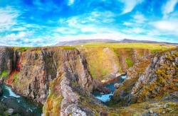 Marvelous view of  Kolugljufur canyon and Kolufossar falls. Kolugljufur gorge is located on river Vididalsa.  Location: Kolufossar waterfall, Vestur-Hunavatnssysla, Iceland, Europe