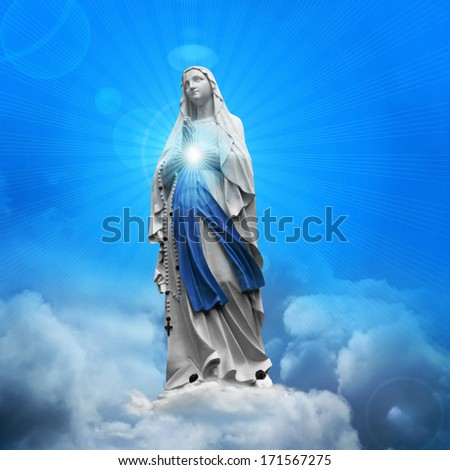 mary virgin statue and blue sky clouds background