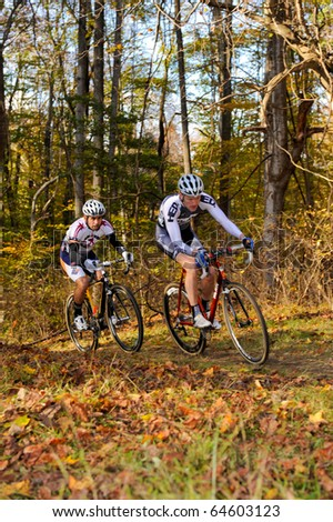 MARYLAND - NOVEMBER 7: Cyclists compete in the Tacchino Ciclocross competition on November 7, 2010 in Upper Marlboro, Maryland. - stock photo
