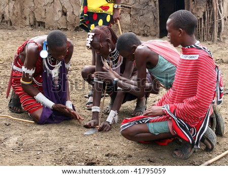 MASAI MARA - JUNE 23: Picture of some masai making a fire without matches. June 23, 2007 in Kenya.