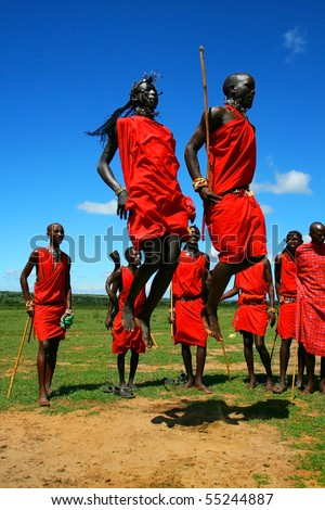 MASAI MARA,KENYA, AFRICA-NOVEMBER 12:Masai warriors dancing traditional jumps as cultural ceremony,review of daily life of local people,near to Masai Mara National Park Reserve,November 12,2008,Kenya - stock photo