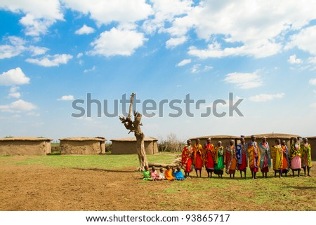 MASAI MARA, KENYA - AUGUST 24: A group of kenyan women of Masai tribe sings a traditional song to welcome their visitors on August 24, 2011 in a local village near Masai Mara National Park, Kenya.