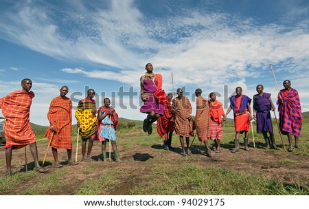 MASAI MARA, KENYA - DECEMBER 2: Unidentified Masai warriors dance and participate in traditional jumps as part of a cultural ceremony on December 2, 2011 in Masai Mara National Park, Masai Mara, Kenya