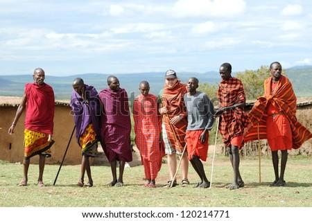 MASAI MARA, KENYA - NOVEMBER 10: Unidentified Masai warriors dance and participate in traditional jumps as part of a cultural ceremony on November 10, 2012 in Masai Mara, Kenya