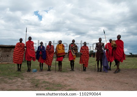 MASAI MARA,TANZANIA, AFRICA- FEB 23: Masai warriors dancing traditional jumps as cultural ceremony, review of daily life of local people. Masai Mara National Park Reserve, feb 23 , 2012, Tanzania