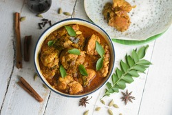Masala Chicken curry with Appam Kerala breakfast , Hoppers pan cake , homemade chicken roast Indian spices , Asian cuisine spicy meat curry cooked in coconut milk . side dish Christian food Christmas