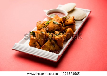 Masala fried Idlies - south indian Snack made using with leftover idly served with tomato ketchup. selective focus