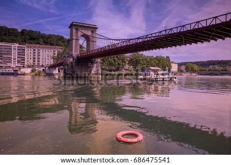 Masaryk Bridge - suspension bridge crossing of the Saône /Lyon, Rhône (69), Auvergne-Rhône-Alpes, France /This suspension bridge over the Saone River near Ile Barbe island in Lyon. #686475541