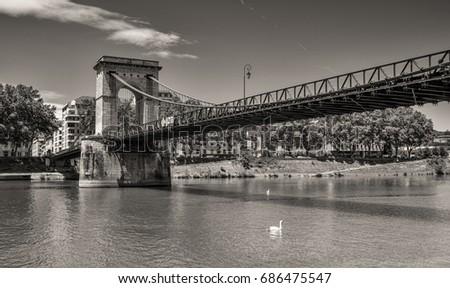 Masaryk Bridge - suspension bridge crossing of the Saône /Lyon, Rhône (69), Auvergne-Rhône-Alpes, France /This suspension bridge over the Saone River near Ile Barbe island in Lyon. #686475547