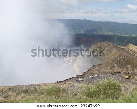 Masaya Volcano National Park looking due north across the crater. Note the vehicles parked facing out for quick exit in case of wind change (not likely)