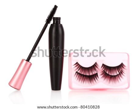 mascara and false eyelashes are isolated on a white