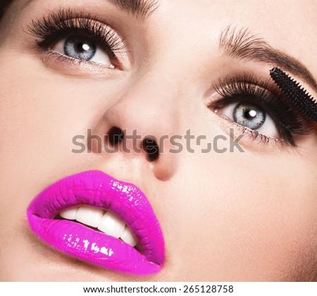 Mascara Applying. Long Lashes closeup. Mascara Brush. Eyelashes extensions. Makeup for Blue Eyes. Eye Make up Apply,pink lips