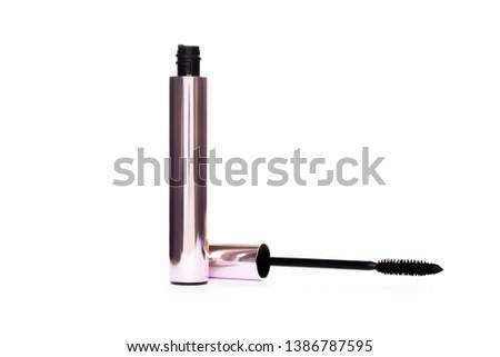 Mascara Bottle and Brush.Fashionable Makeup for the Eyes, Black Mascara wand and Tube Isolated on White.розовая Bottle.Mascara on Light Background.Mascara New Formula - Volume, fluffy, - Image