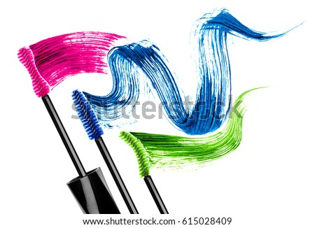 Mascara brushes with colored mascara strokes, isolated on white background