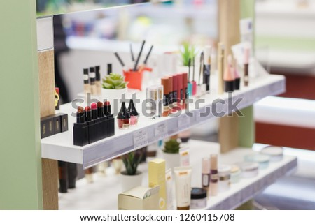 Mascara, lipsticks testers and skin care products in the cosmetic store.