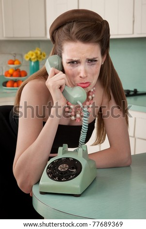 Mascara smeared housewife crys on phone in a retro-style scene