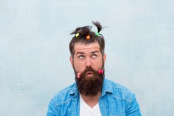 Masculine enough. Having fun party. Man adult bearded handsome hipster childish hairstyle colorful ponytails. Hair accessory. Made for fun. Funny style. Crazy guy. Fun with hair. Hairdresser salon.
