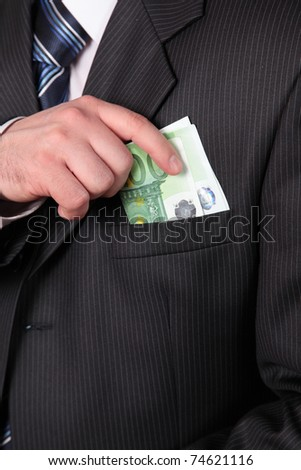 masculine hand, taking away money in the pocket of coat